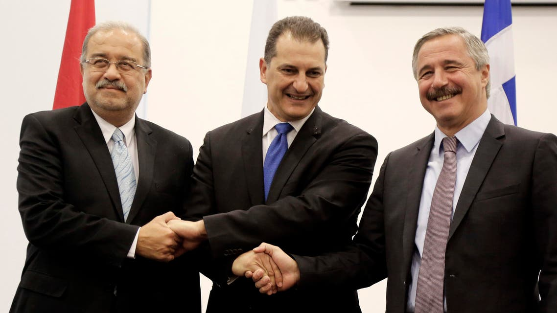 Cypriot Energy Minister Giorgos Lakkotrypis, center, shakes hands with his counterparts of Egypt Sherif Ismail, left, and Greece' Yiannis Maniatis