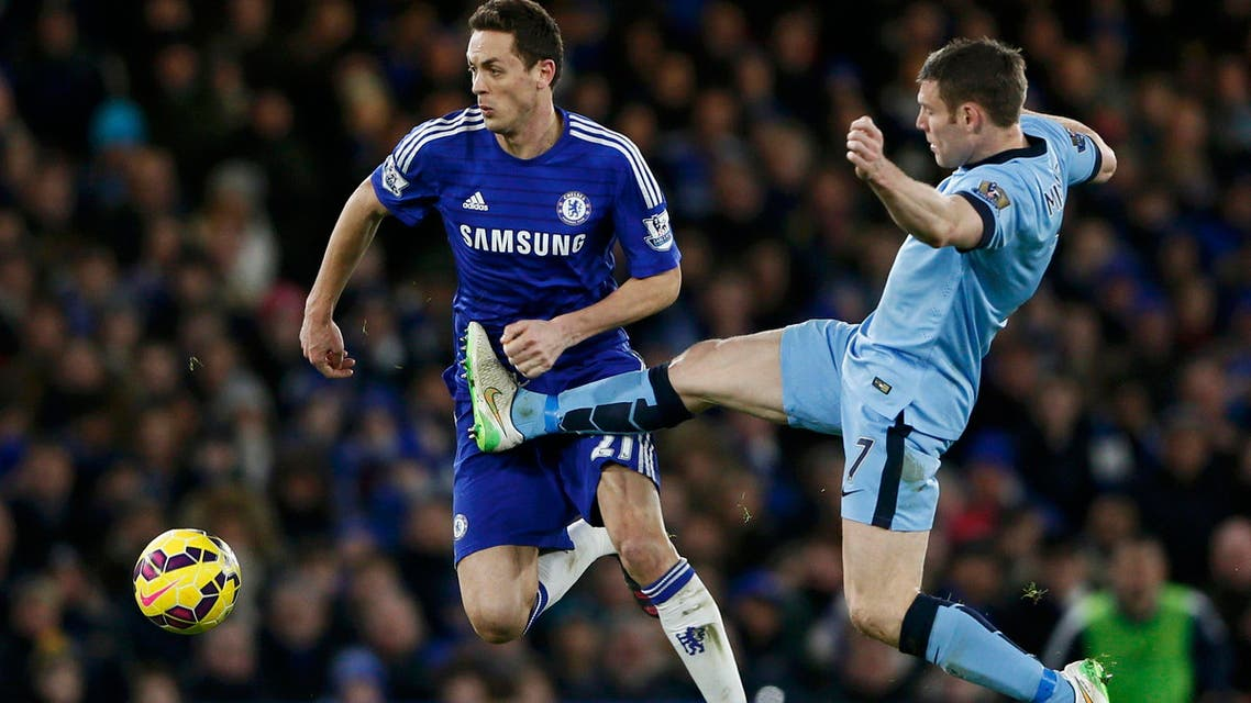 Chelsea's Nemanja Matic (L) is challenged by Manchester City's James Milner during their English Premier League soccer match at Stamford Bridge in London Jan. 31, 2015.  (Reuters)