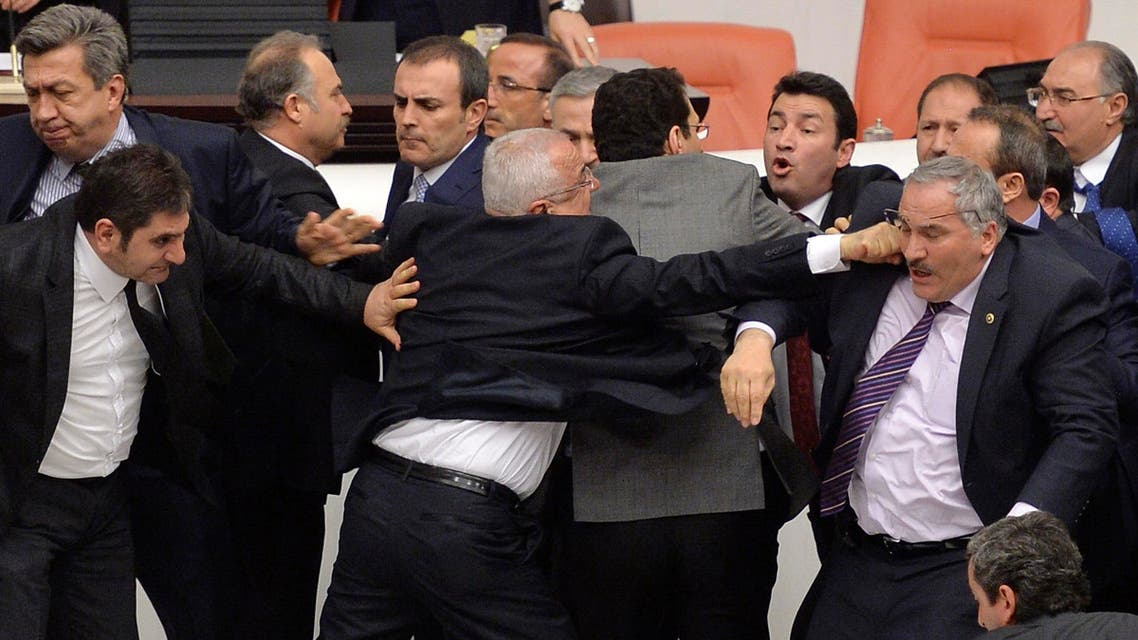 Main opposition Republican People's Party (CHP) and ruling AK Party (R) lawmakers scuffle during a debate on a legislation to boost police powers, at the Turkish Parliament in Ankara late February 19, 2015. Reuters