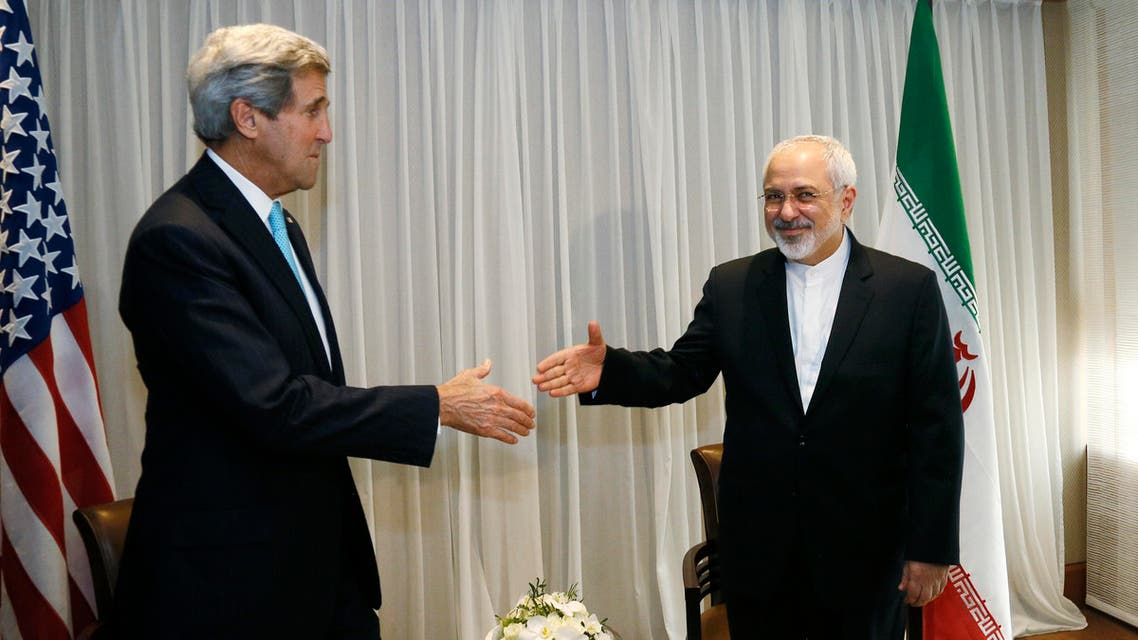 U.S. Secretary of State John Kerry, left, shakes hands with Iranian Foreign Minister Mohammad Javad Zarif before a meeting in Geneva, Switzerland Wednesday, Jan. 14, 2015. AP