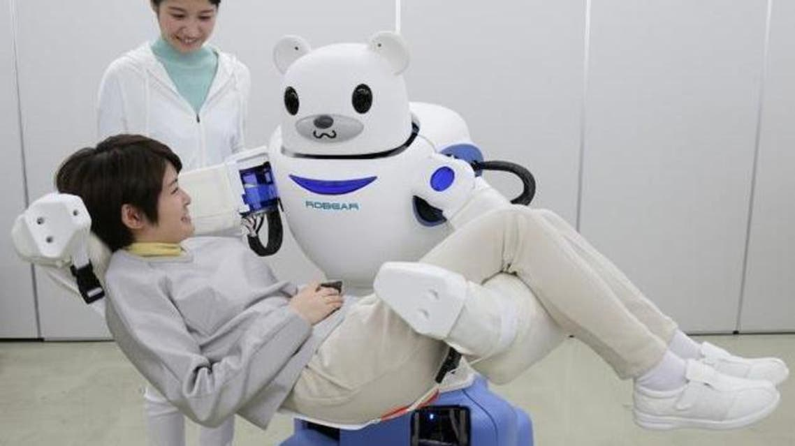 A 'Robear' lifts a woman during a demonstration in Nagoya, central Japan, on February 23, 2015 AFP