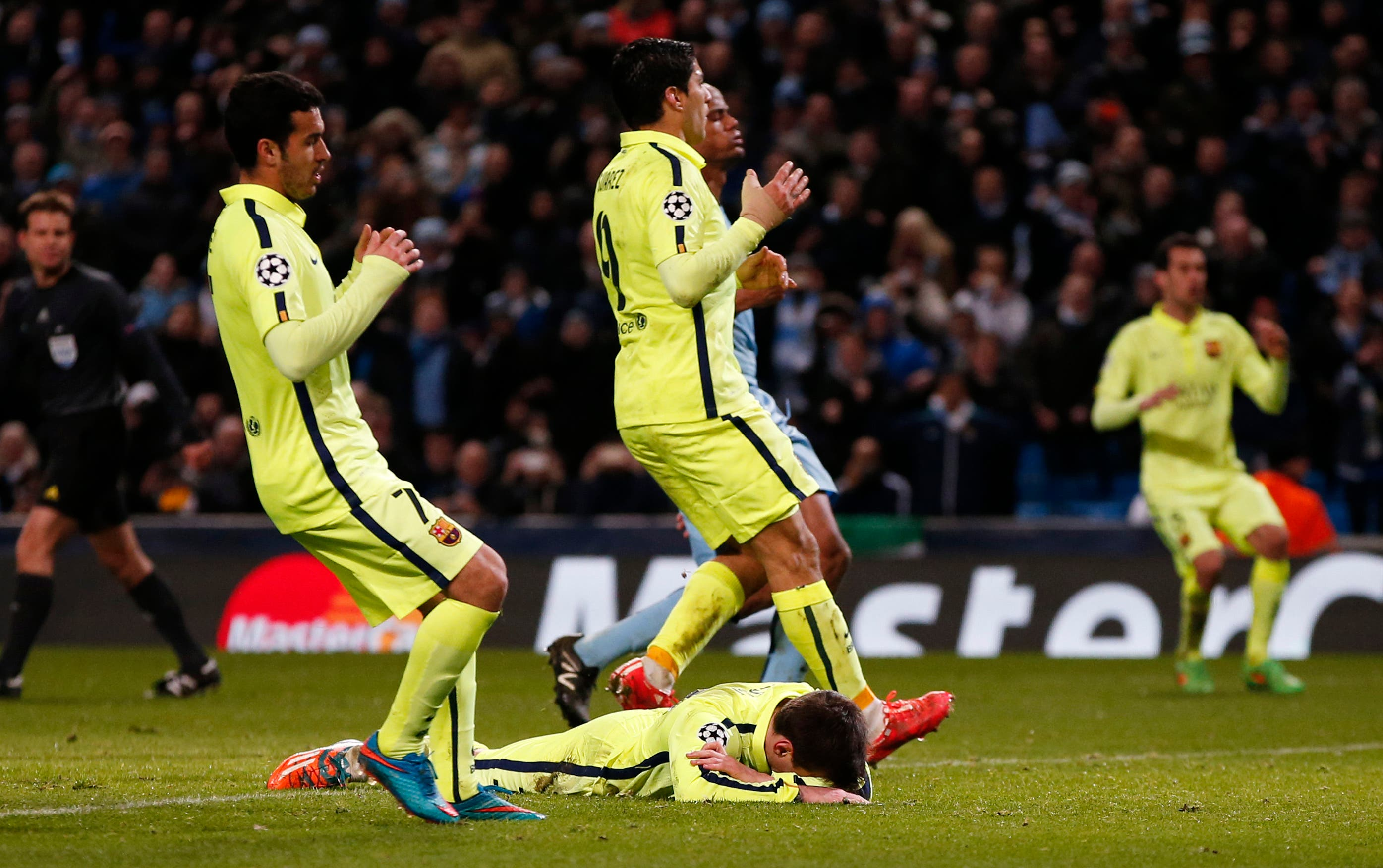 Barcelona's Lionel Messi looks dejected after having his penalty saved. (Reuters)