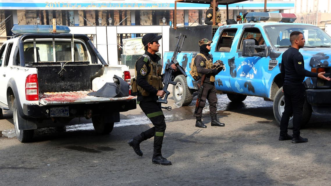 Security forces inspect the site of a twin bombing at a crowded market in Baghdad Iraq, Friday, Jan. 30, 2015. AP