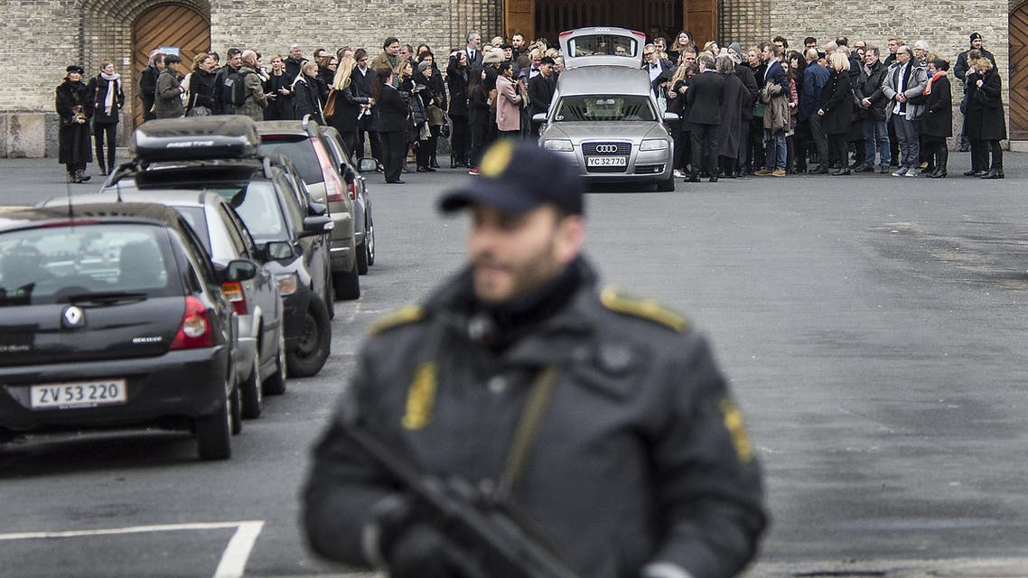 The coffin of Danish filmmaker Finn Noergaard who was killed in one of the two attacks in Copenhagen, is brought out after the funeral service at Grundvigs Church, in Copenhagen, Feb. 24, 2015. (AP)