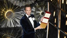Oscars TV ratings slump, critics slam presenter