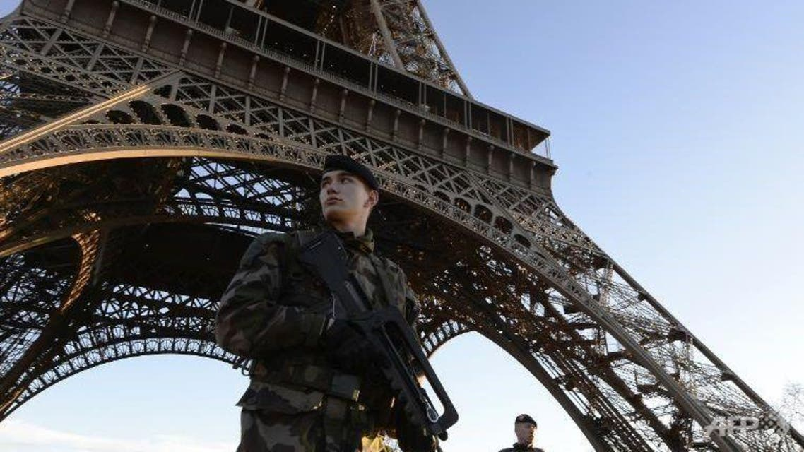 French soldiers patrol in front of the Eiffel Tower in Paris, Jan 8, 2015. (AFP/Bertrand Guay)