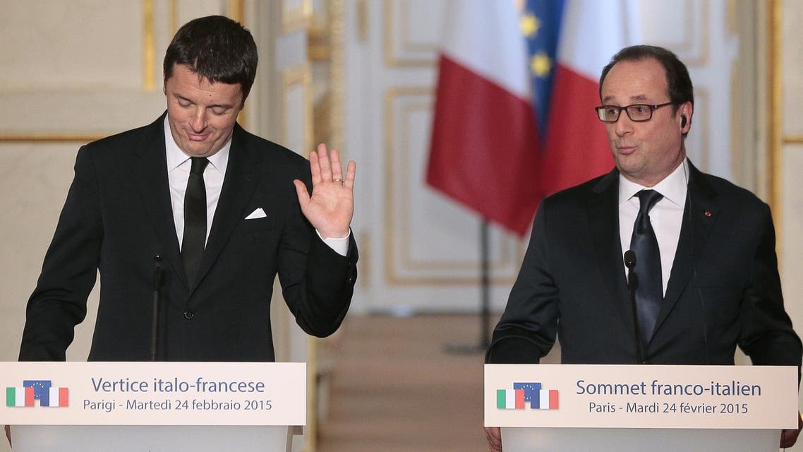 Italian Prime Minister Matteo Renzi (L) and French President Francois Hollande (R) give a press conference during a Franco-Italian summit at the Elysee Palace on Feb. 24, 2015 in Paris. (AFP)