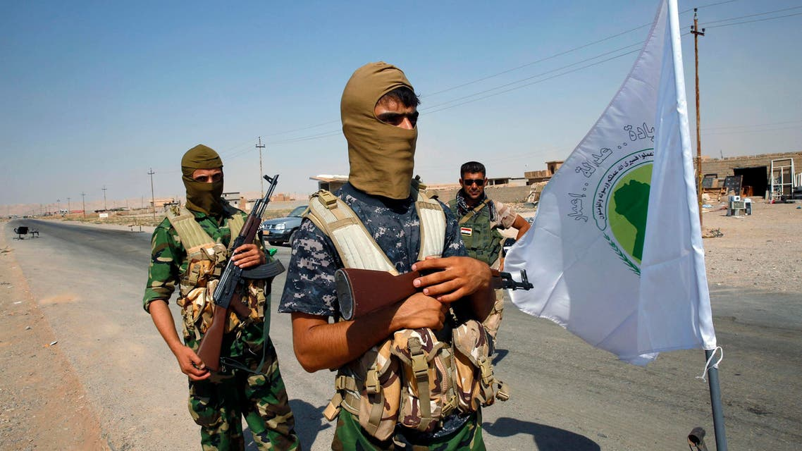 Fighters from the Shi'ite Badr Brigade militia guard a checkpoint outside the town of Sulaiman Pek. (File Photo: Reuters)