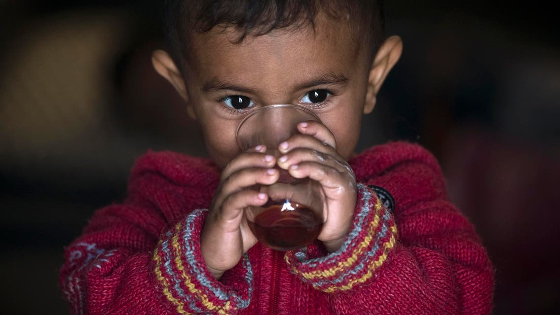 A Syrian Kurdish refugee child from the Kobane area, drinks tea at a camp in Suruc, on the Turkey-Syria border Wednesday, Nov. 12, 2014. (AP)