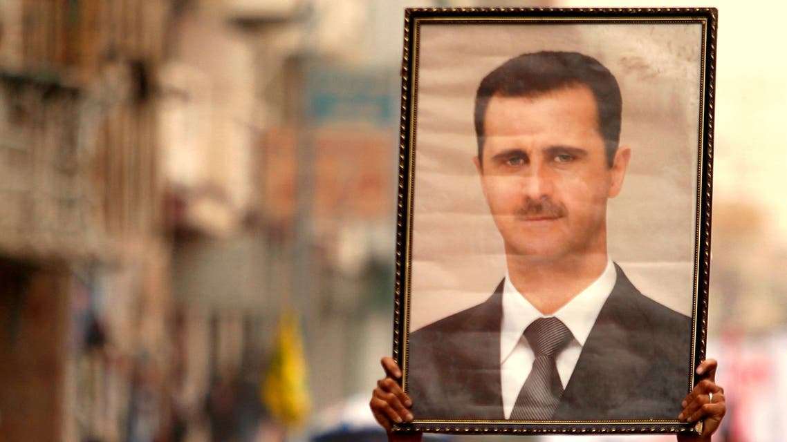 President Bashar al-Assad during a demonstration against Israeli air strikes in Syria, in Sanaa, May 10, 2013. Reuters