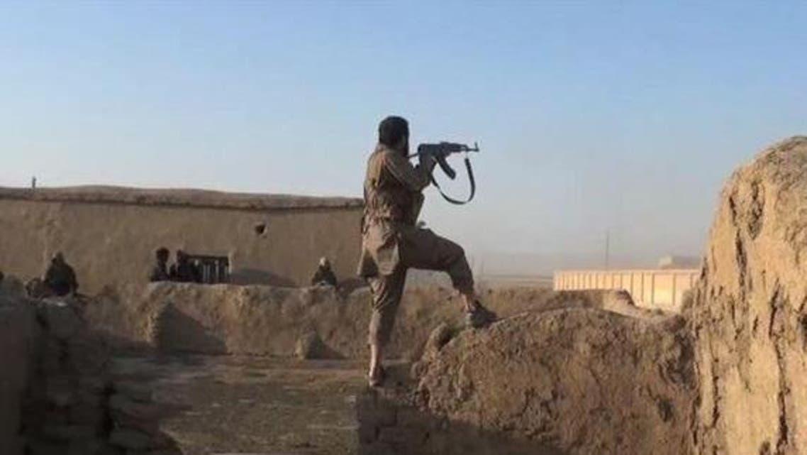 عناصر من تنظيم داعش خلال استهدافهم لقرى آشورية 3