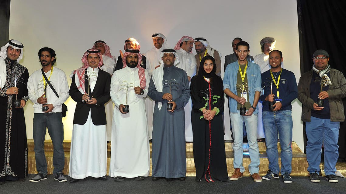 Saudi filmmakers and actors pose for a group picture with their awards on the last day of the Saudi Film Festival at Saudi culture center in the City of Dammam, some 400 km east of the capital Riyadh, on Feb. 24, 2015.  (AFP)