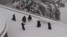 Snow day! Jerusalem monks have snowball fight on rooftop
