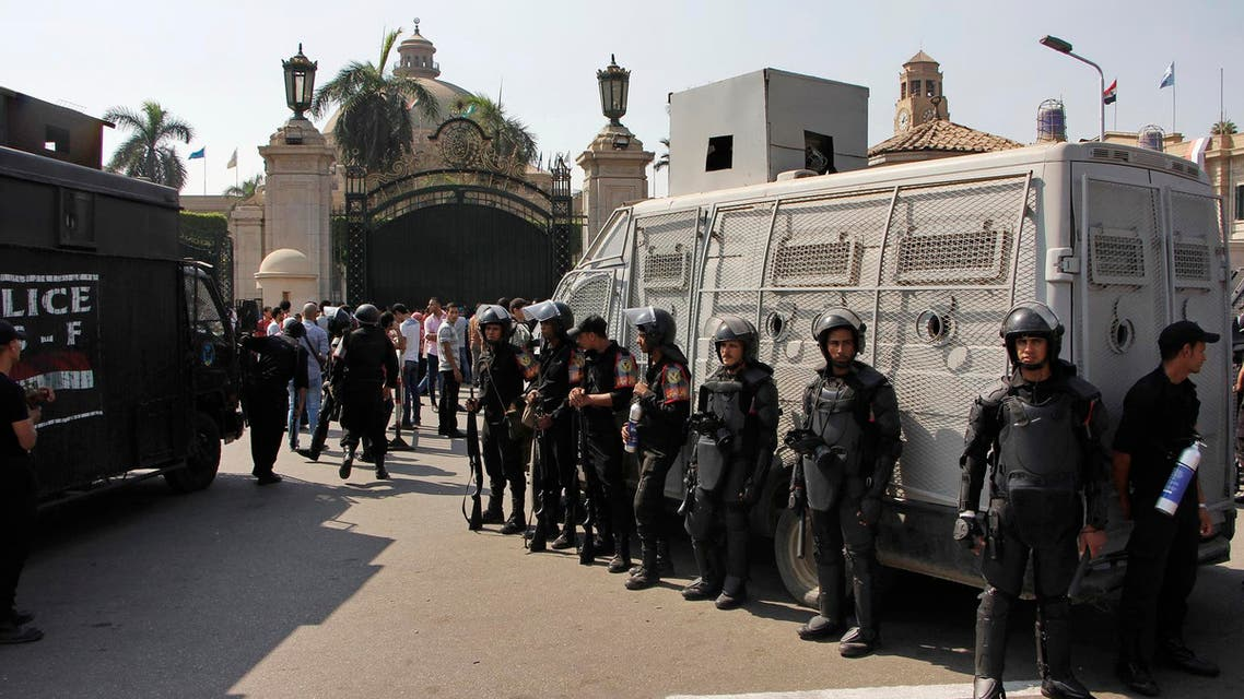 Egyptian security forces stand guard at Cairo University in Cairo, Egypt, Sunday, Oct. 12, 2014. (AP)