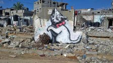 Graffitist Banksy unveils giant kitten art in Gaza video tour