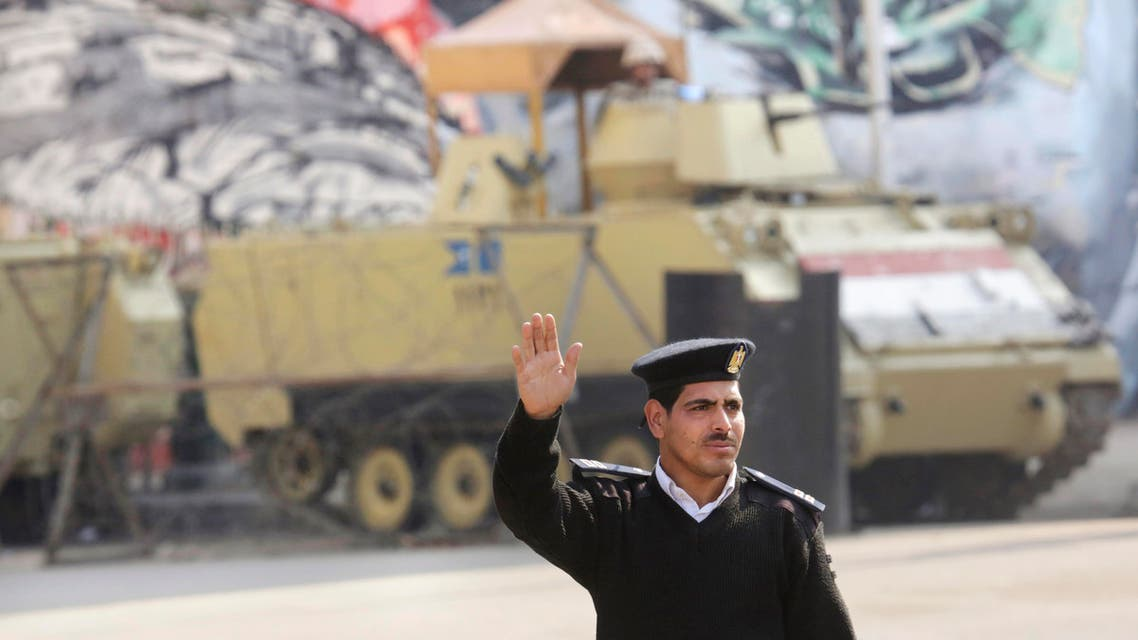An Egyptian policeman waves at passing vehicles in front of an armored vehicle guarding Tahrir Square in Cairo, Egypt, Friday, Nov. 28, 2014. (File photo: AP)