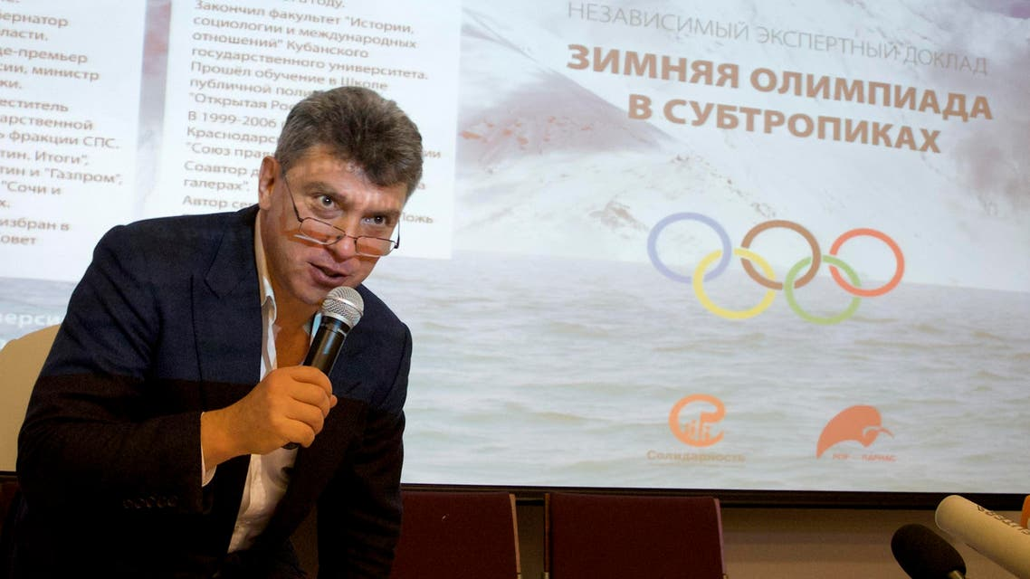 Boris Nemtsov, a former Russian deputy prime minister, presents a report claiming a multibillion-dollar corruption at 2014 Winter Games in Sochi, at a news conference in Moscow, Russia, Thursday, May 30, 2013.
