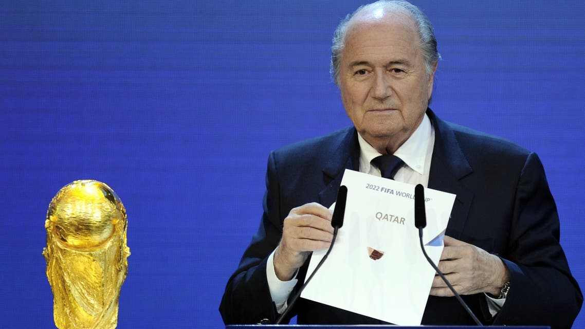 A file photo taken on December 2, 2010 shows FIFA President Sepp Blatter holding up the name of Qatar during the official announcement of the 2022 World Cup host country at the FIFA headquarters in Zurich. (AFP)