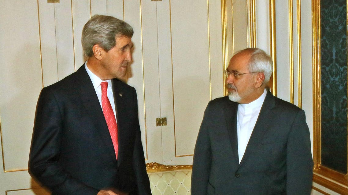 U.S. Secretary of State John Kerry and Iranian Foreign Minister Mohammad Javad Zarif, right, pose for a photograph prior to a bilateral meeting of the closed-door nuclear talks with Iran in Vienna, Austria, Sunday, Nov. 23, 2014. (AP)