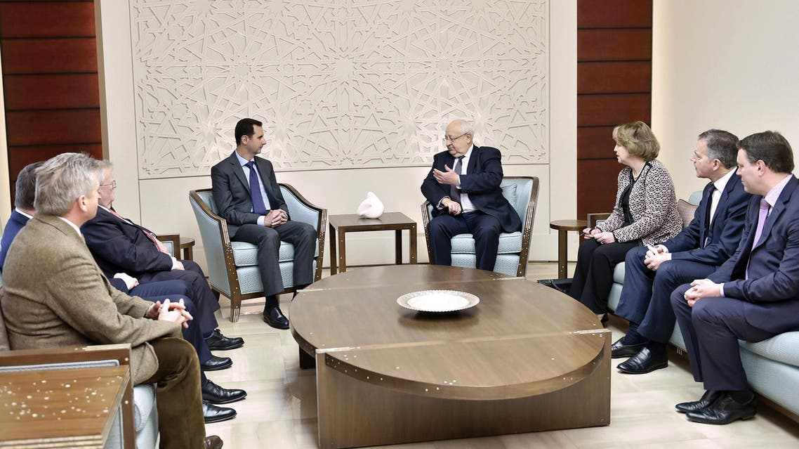 A handout picture released by the Syrian Arab News Agency (SANA) on February 25, 2015 shows Syrian President Bashar al-Assad (C-L) meeting with French lawmakers. (AFP)