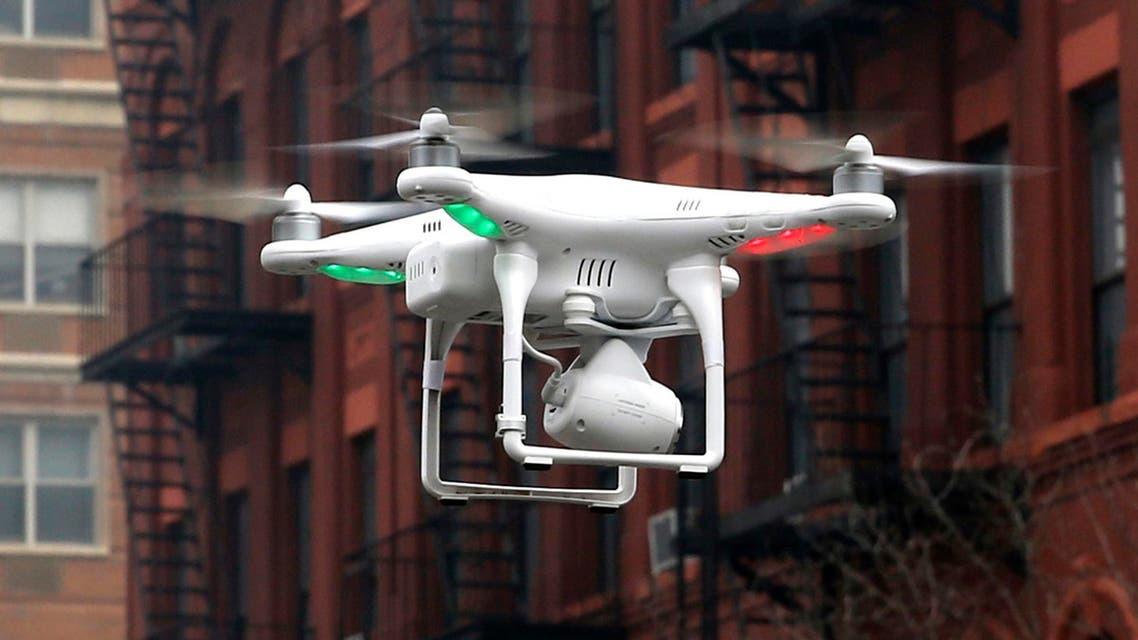 A camera drone operated by a civilian flies near the scene where two buildings were destroyed in an explosion in New York, in this file photo taken March 12, 2014. (Reuters)