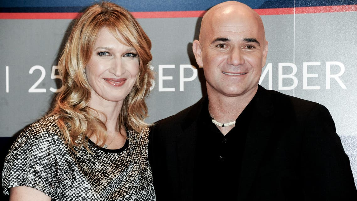 Steffi Graf, left, and Andre Agassi attend Longines Los Angeles Masters on Saturday, Sept. 27, 2014, in Los Angeles. (AP)