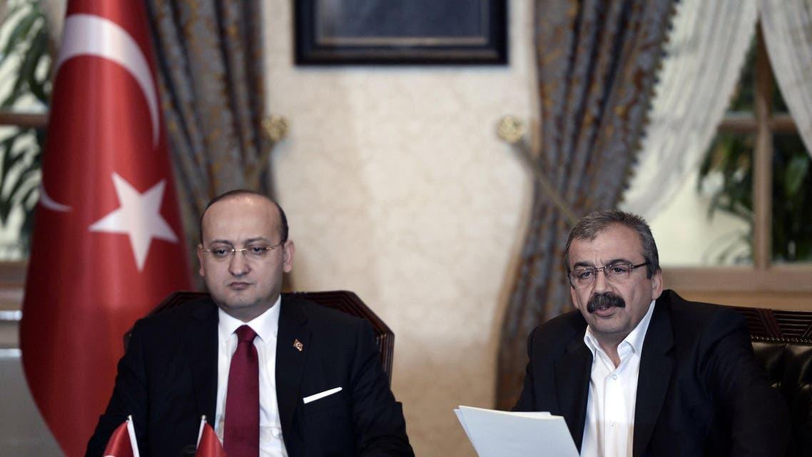 Sirri Sureyya Onder, right, speaking next to Turkey's Deputy Prime Minister Yalcin Akdogan, left. AFP