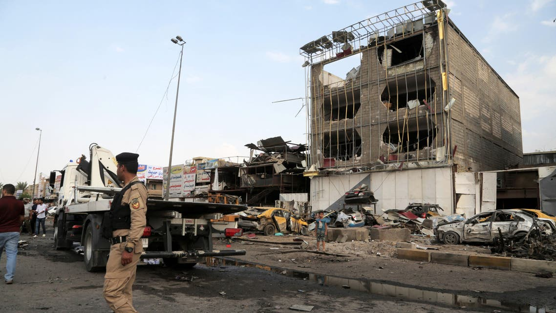 Security forces inspect the site of a car bomb explosion in the largely Shiite eastern neighborhood of Talibiyah in Baghdad, Iraq, Thursday, Oct. 16, 2014. AP