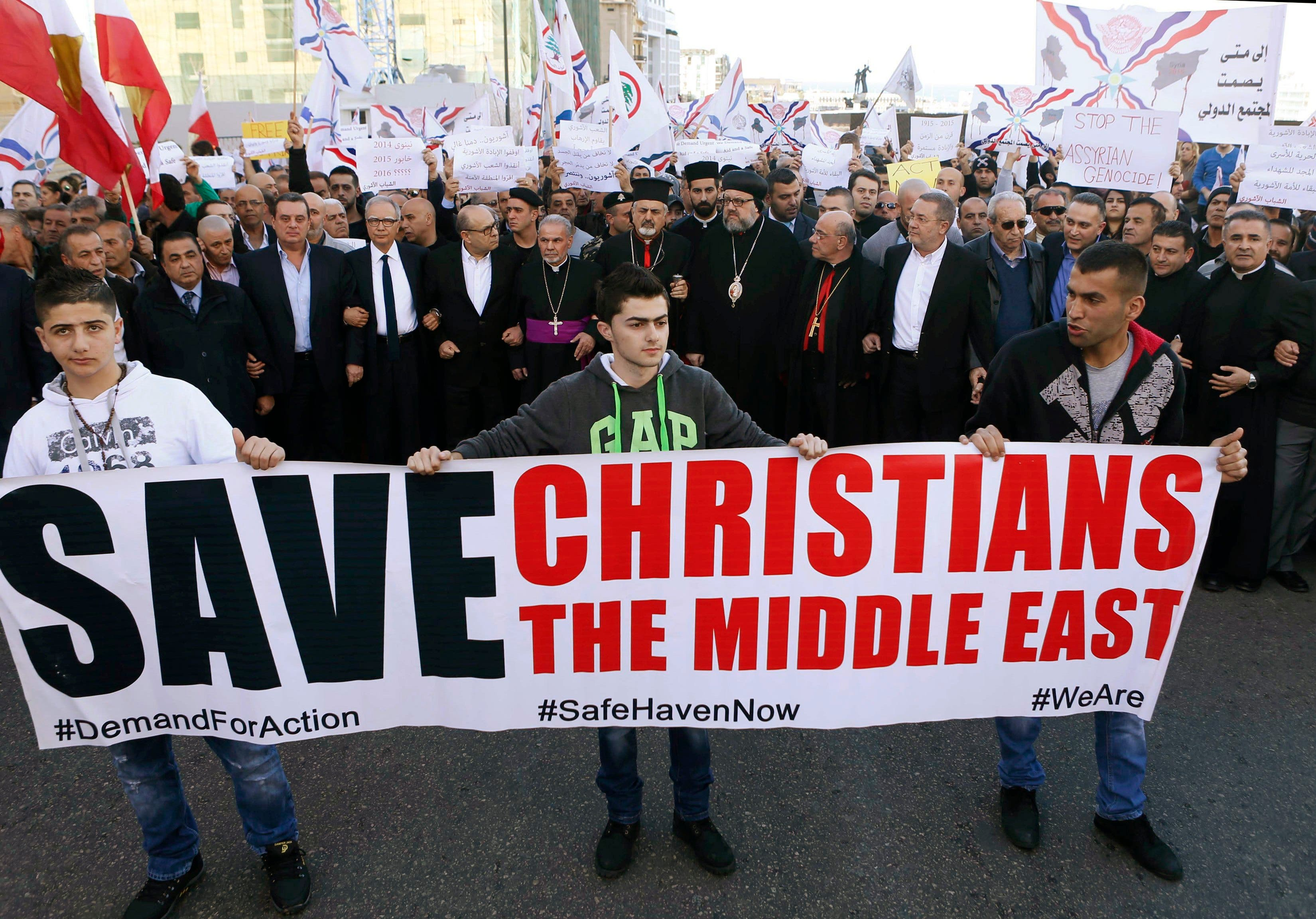 Assyrians hold placards during a gathering, on February 28, 2015 in the Lebanese capital Beirut. (Reuters)