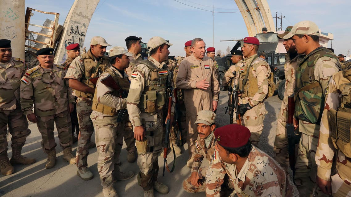 Iraqi Defense Minister Khalid al-Obeidi, center, speaks to his soldiers after a military operation to regain control of the university of Tikrit, 130 kilometers north of Baghdad, Iraq in 2014. (File photo: AP)