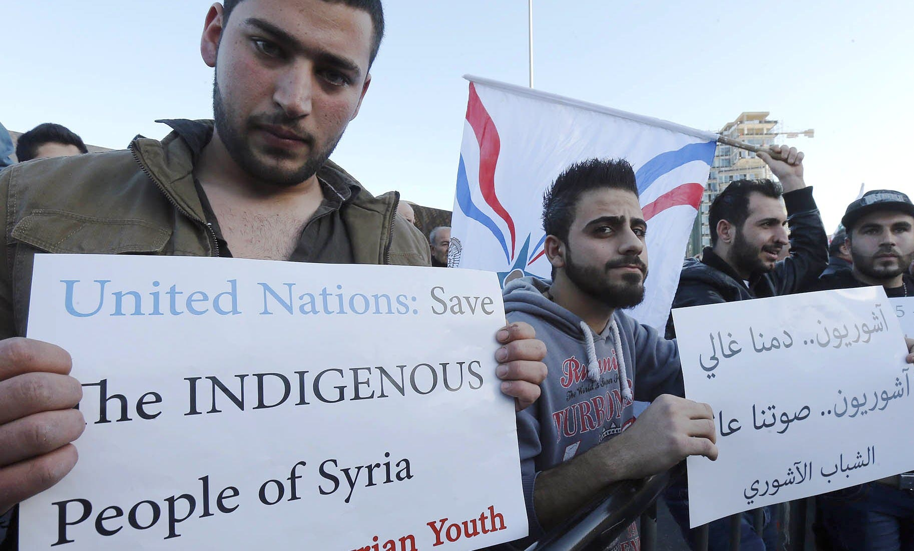 Assyrian hold placards during a gathering, on February 28, 2015 in the Lebanese capital Beirut. (AFP)