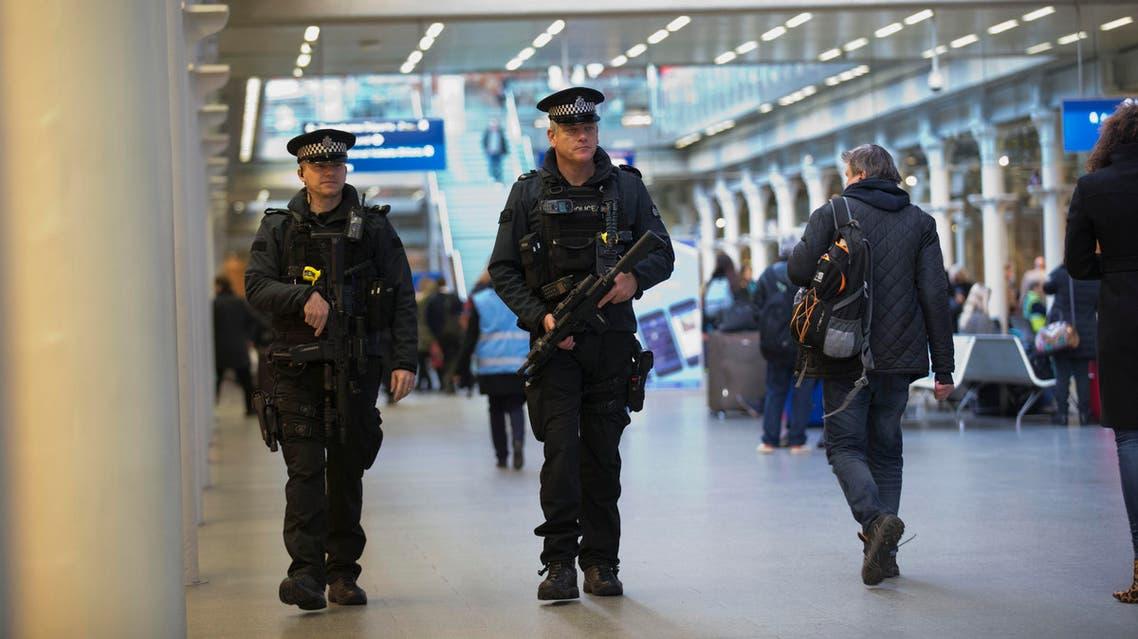 Armed British police patrol St. Pancras train station in London, where the Eurostar train runs to Paris, Friday, Jan. 9, 2015. AP