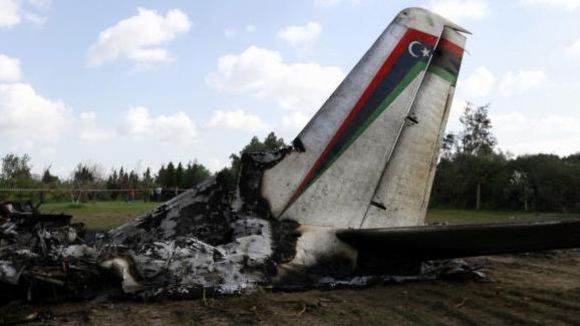 The wreckage of a Libyan military plane that crashed near Grombalia town, south of Tunis, is seen February 21, 2014. reuters