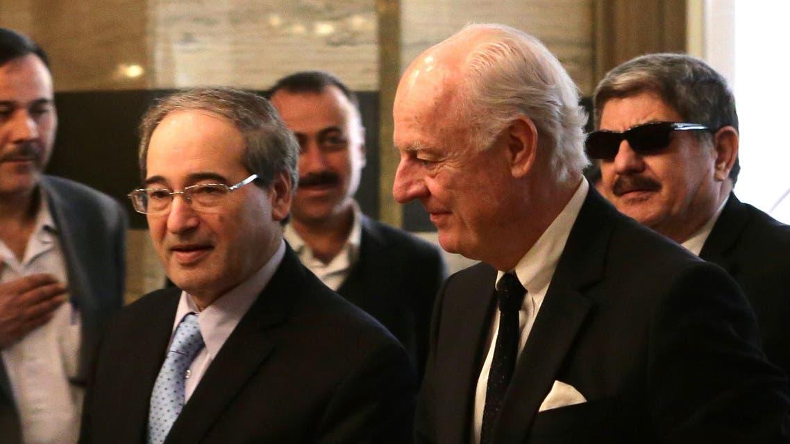 Staffan de Mistura and Faisal Muqdad AFP