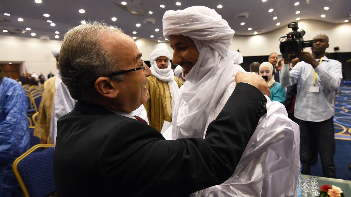 Algerian Foreign Minister Ramtane Lamamra (L) hugs Mali's Bilal Acherif, the general secretary of the National Movement for the Liberation of Azawad. AFP