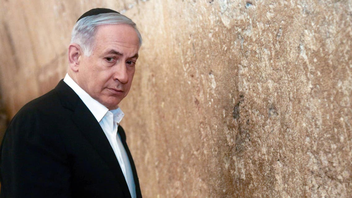 Hours before flying to Washington, the Israeli premier made a high-profile visit to Jerusalem's Western Wall. (Reuters)