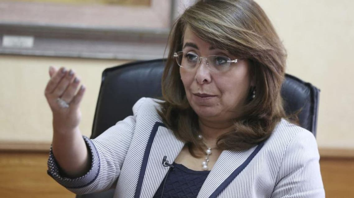 Egyptian Minister of Social Solidarity Ghada Wali talks during an interview at her office in Cairo, Oct. 20, 2014. REUTERS