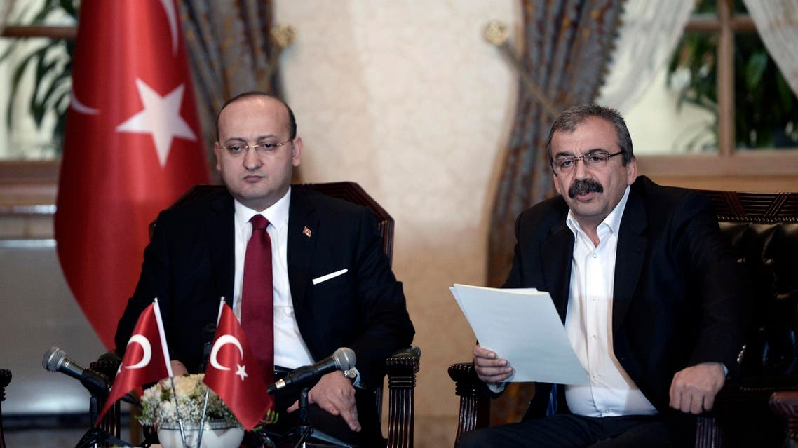 Sirri Sureyya Onder, a lawmaker of the pro-Kurdish Peoples' Democratic Party (HDP), reads a statement during a meeting with Turkey's Deputy Prime Minister Yalcin Akdogan (L) in Istanbul February 28, 2015. (Reuters)