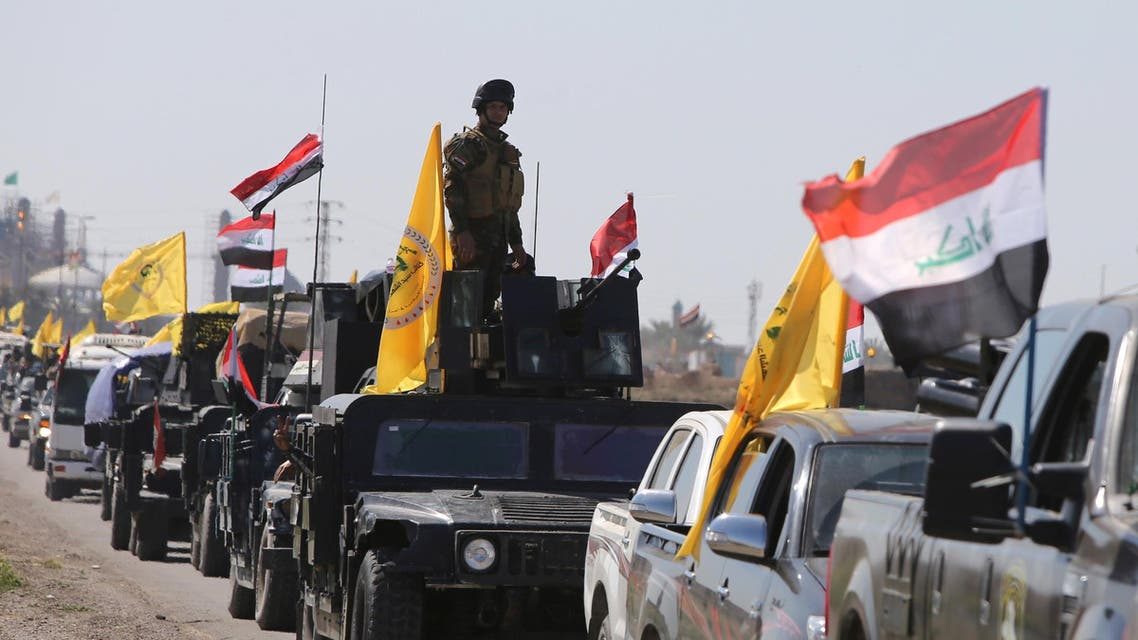 Members of the Iraqi security forces heading from the city of Samarra north of Baghdad drive towards al-Dawr area south of Tikrit to launch an assault against the Islamic State group (IS) on February 28, 2015. AFP