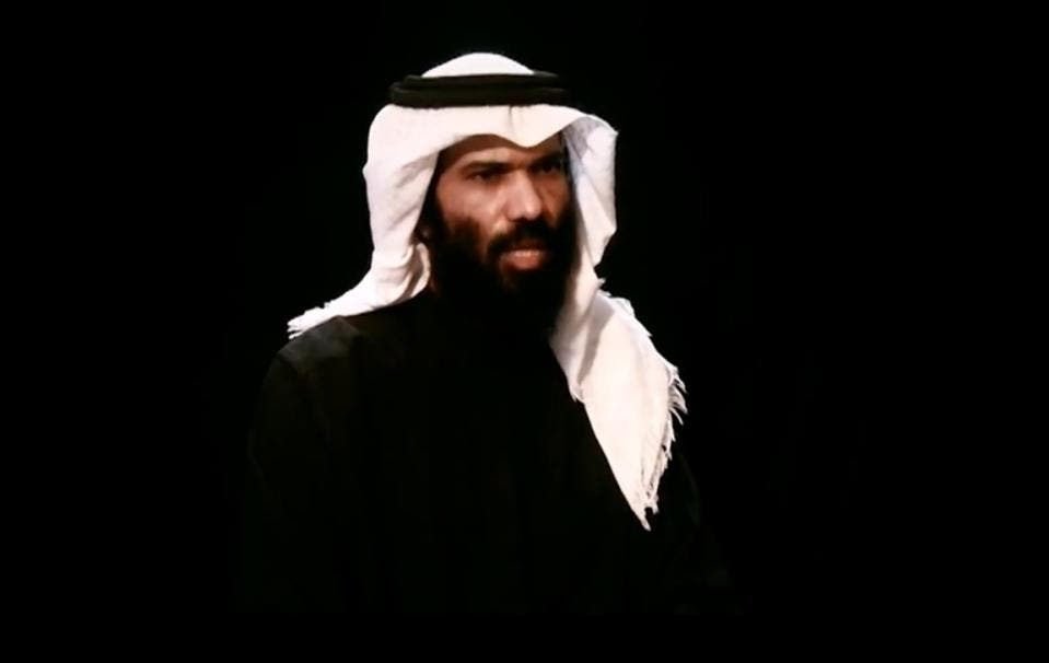 An image grab from a video uploaded to YouTube on April 15, 2013 shows Saudi's deputy consul Abdullah al-Khalidi speaking at an unknown location during a 19-minute video interview by Al-Malahim Media (AFP Photo/)