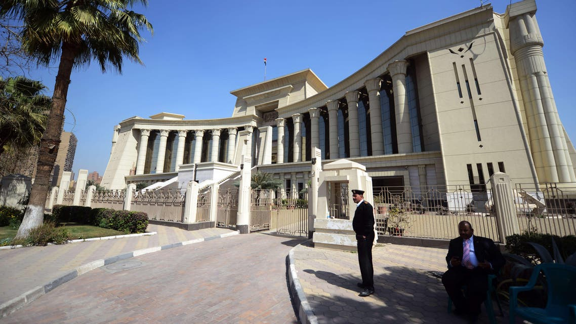 A member of the Egyptian security forces stands guard outside the constitutional court during a session to rule on the law organizing the upcoming parliamentary elections on March 1, 2015 in the capital Cairo. (AFP)