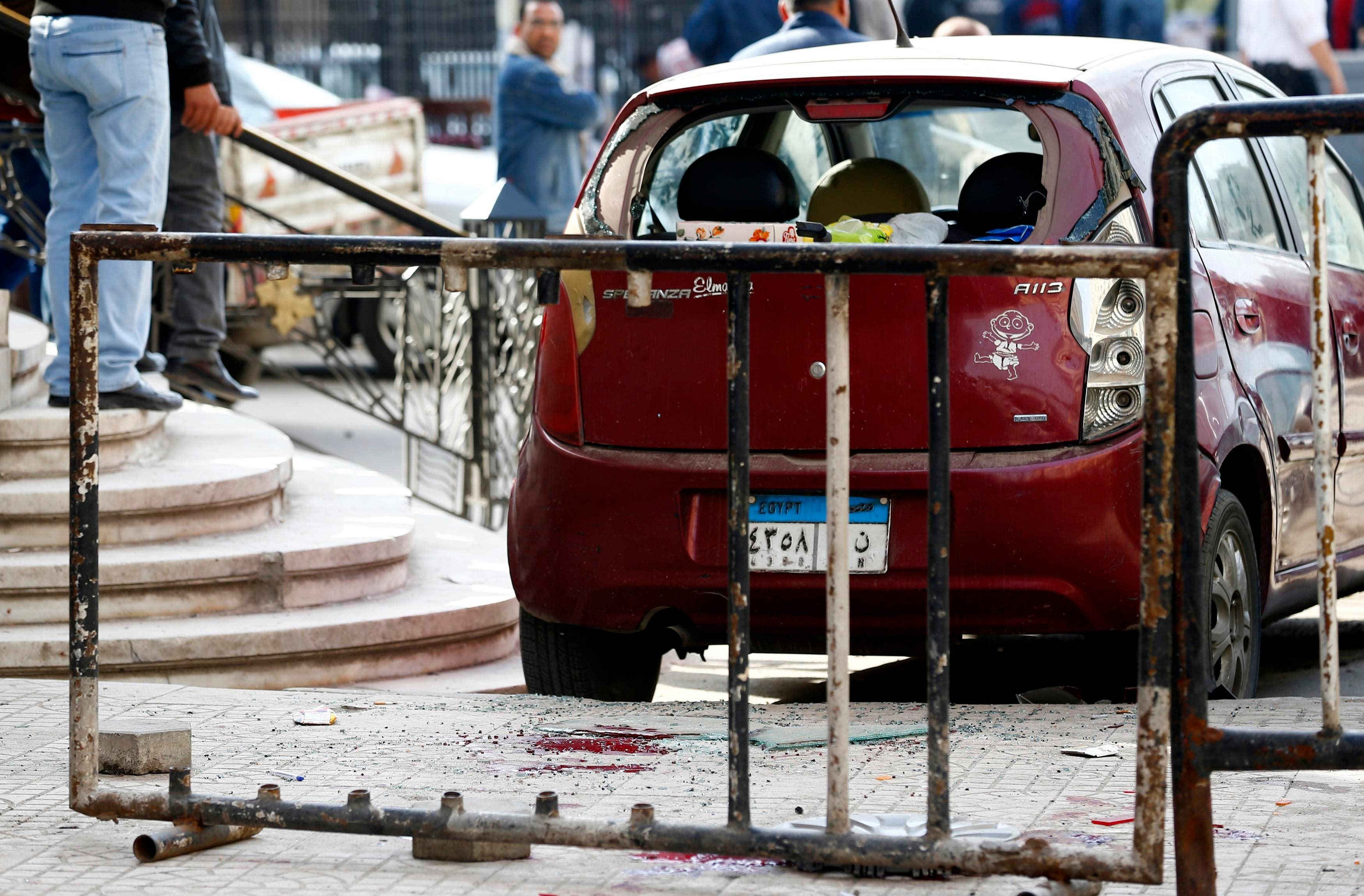 Blood stains are seen on the ground as security officials inspect the scene of a car bomb blast in front of The High Court in downtown Cairo, March 2, 2015. (Reuters)