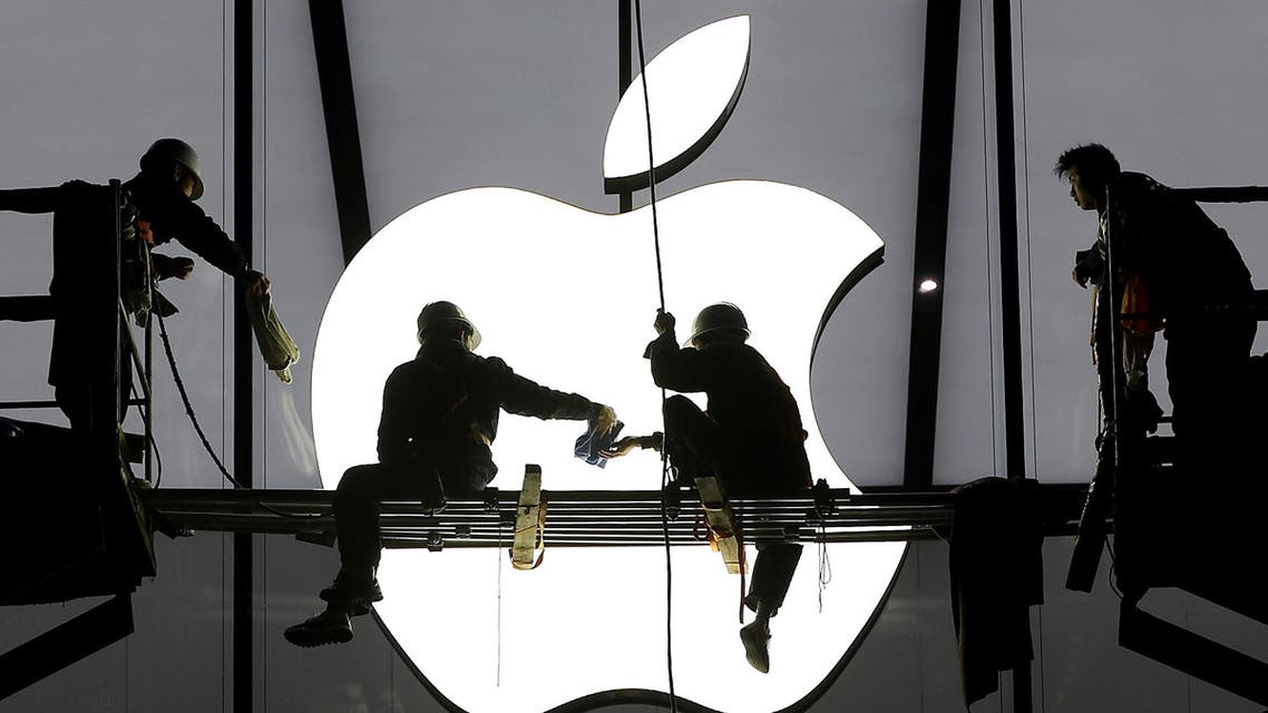 Workers prepare for the opening of an Apple store in Hangzhou, Zhejiang province, in this January 23, 2015 file photo. (Reuters)