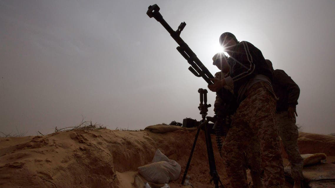 In this Saturday, Feb. 21, 2015 photo, Libyan soldiers try to fix a weapon that jammed during clashes with militants on the frontline in Al Ajaylat, 120 kilometers (75 miles) west of Tripoli, Libya. (AP)