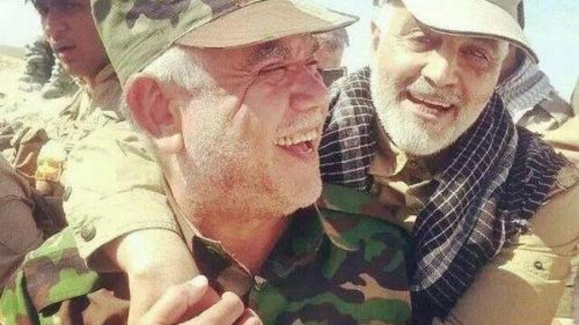 A photograph posted by Mashregh News, an Iranian outlet close to the country's Revolutionary Guards Corps, that shows top Iranian general Qassem Soleimani embracing the leader of Iraq's Shiite Badr militia Hadi al-Amiri. This picture is not dated, but is thought to have been taken in 2014.