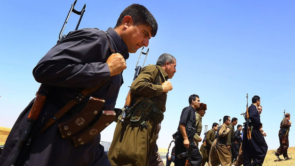 in this Saturday, June 14, 2014 file photo, Kurdish Peshmerga security forces stand guard on the outskirts of the northern city of Mosul, Iraq.