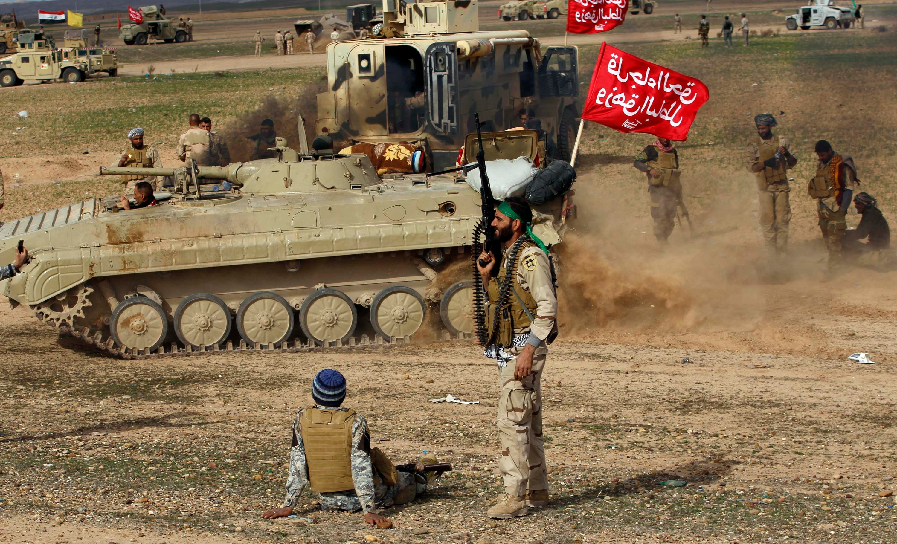 Shi'ite fighters sit in front of a tank during deployments in the town of Hamrin in Salahuddin province March 3, 2015. (Reuters)