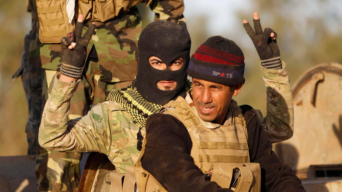 A Shi'ite fighter gestures during clashes with Islamic State militants in Salahuddin province March 2, 2015. Reuters