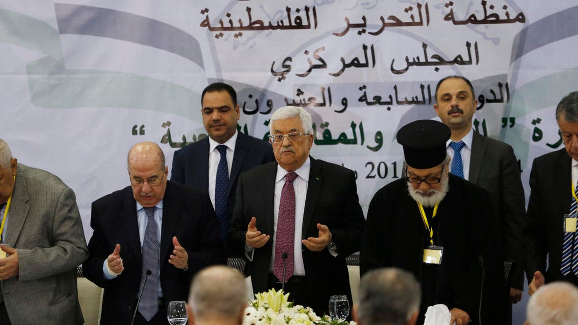 Palestinian President Mahmoud Abbas (C) prays at the start of a meeting for the Central Council of the Palestinian Liberation Organization. (Reuters)