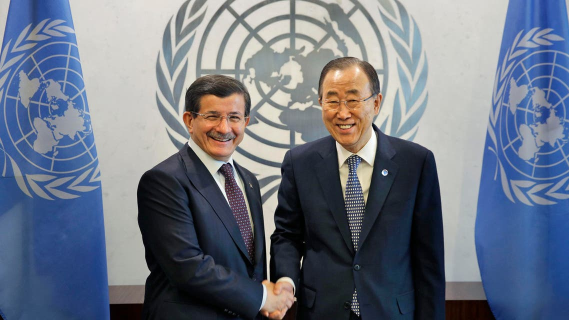United Nations Secretary General Ban Ki-moon, right, shakes hands with Ahmet Davutoglu, Prime Minster of Turkey, at UN headquarters, Thursday, March 5, 2015. (AP)